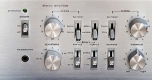 Vintage Stereo Amplifier Shiny Metal Front Panel Controls. Front View stock photo