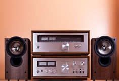 Vintage Stereo Amplifier tuner speakers. Vintage hi-fi Stereo Amplifier tuner and speakers in wooden cabinets, front Royalty Free Stock Photo