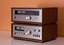 Vintage Stereo Amplifier and tuner wooden cabinets Royalty Free Stock Photos