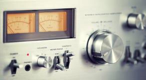 Vintage Stereo Audio Amplifier Front Panel Volume Knob. Closeup royalty free stock photo