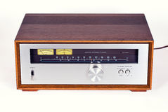 Vintage Stereo Audio Tuner Radio in Wooden cabinet. On white background, frontal view royalty free stock photo