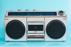 Vintage stereo on blue pastel color background.  royalty free stock images