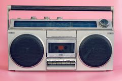 Vintage stereo on pink pastel color background.  royalty free stock photography