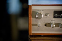 Vintage stereo receiver in wooden cabinet Royalty Free Stock Image