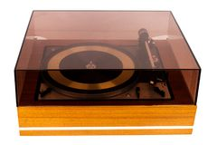 Vintage stereo turntable vinyl record player with a dust cover. Isolated on white background stock photo