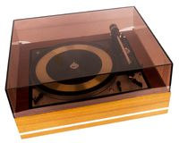 Vintage stereo turntable vinyl record player with a dust cover. Isolated on white background stock images