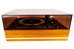 Vintage stereo turntable vinyl record player with a dust cover. Isolated on white background royalty free stock image