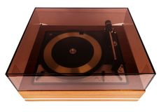 Vintage stereo turntable vinyl record player with a dust cover. Isolated on white background royalty free stock photos