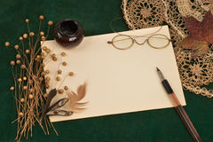 Vintage Still Life. With pen, inkstand and glasses stock photos