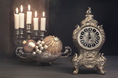 Vintage still life with alarm clock on Christmas Eve Royalty Free Stock Images