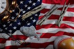 vintage still life, the American flag, old alarm clock, glasses, baseball, clothespins, fish