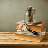 Vintage still life with books on wooden table Royalty Free Stock Photos