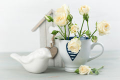 Vintage still life. Bouquet of white roses Royalty Free Stock Image