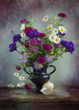 Vintage Still life with a bouquet of wildflowers in a vase. Still life with a bouquet of wildflowers in a vase Stock Photo