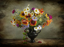 Vintage Still life with a bouquet of wildflowers in a vase Royalty Free Stock Photography