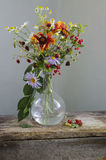 Vintage Still life with a bouquet of wildflowers in a vase. Still life with a bouquet of wildflowers in a vase Stock Image
