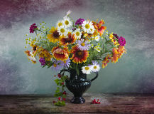 Vintage Still life with a bouquet of wildflowers in a vase. Still life with a bouquet of wildflowers in a vase Royalty Free Stock Image