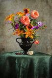 Vintage Still life with a bouquet of wildflowers in a vase Stock Photos