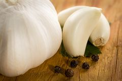 Vintage still life with garlic, pepper, close-up Royalty Free Stock Images