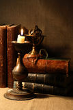Vintage Still Life. With lighting candle near old books Stock Images