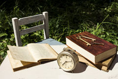 Vintage still life with old alarm clock, keys and books royalty free stock photos