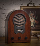 Vintage still life of an old analogue wooden radio and golden fr Royalty Free Stock Images