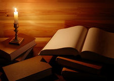 Vintage still life with old books and candle Royalty Free Stock Photos