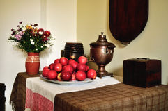 Vintage still life in old russian rural style with old samovar and apples on the tray Royalty Free Stock Photos