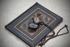 Vintage still life with pocket watch and old book Royalty Free Stock Photography