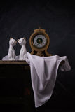 Vintage still life with porcelain figurines Stock Photo
