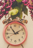 Vintage Still Life with Roses. Vintage Still Life with pink alarm clock royalty free stock images