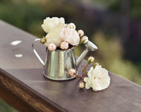 Vintage still life with roses and watering can Stock Photography