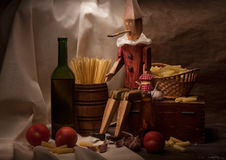 Vintage still life with spaghetti and Pinocchio Stock Images