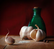 Vintage still life with spices. Vintage still life with garlic, salt and allspice royalty free stock photo