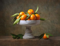 Vintage still life with tangerines. In vase for fruits Royalty Free Stock Photo