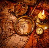 Vintage still life. Vintage items on ancient map. Royalty Free Stock Photo