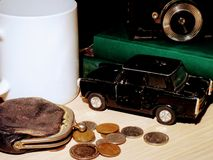 Vintage scene with wallet, coins and toy car. royalty free stock photo