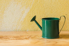 Vintage still life. With watering pot and grunge background royalty free stock images