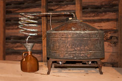 Vintage Still. This vintage still was once used to produce moonshine whiskey which is known as White Lightning stock images