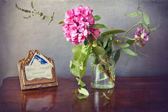 Vintage stilllife, a hydrangea in vase and a card brass holder Stock Image