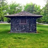 Vintage Stone Outbuilding in the Park. On a Bright Day Royalty Free Stock Photography