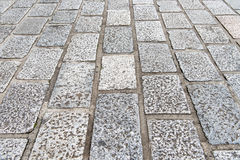 Vintage stone street road pavement texture. Stock Photography