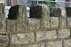 Vintage stone wall outside old church. Vintage stone wall outside old abandoned church stock photography