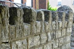 Vintage stone wall outside old church. Vintage stone wall outside old abandoned church royalty free stock photography