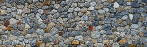 Vintage stone wall panorama background. Close-up Stock Photo