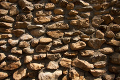 Vintage stone wall surface with cement. Closeup old stone wall Stock Photography