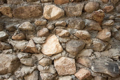 Vintage stone wall surface with cement. Closeup old stone wall.  Royalty Free Stock Photo