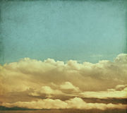 Vintage Storm Clouds. Winter storm clouds rendered with vintage colors.  Image has a pleasing paper grain and texture visible at 100 Stock Images