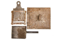 Vintage stove door and fireplace  irons Stock Photo