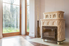 Vintage stove. White vintage style stove in living room royalty free stock photo